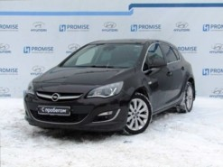 Opel Astra 2014 г. (коричневый)